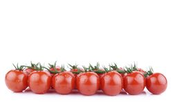 Bunch of cherry tomatoes. Bunch of ripe red cherry tomatoes isolated on white Royalty Free Stock Images