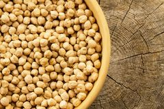 Bunch of chickpeas in a bowl on old wooden background Royalty Free Stock Images