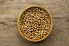 Bunch of chickpeas in bowl on old wooden background Royalty Free Stock Photography