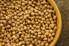 Bunch of chickpeas in a bowl on old wooden background Stock Photos