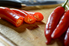 Bunch of chilies on a cutting board. Close up red chilies on a cutting board Royalty Free Stock Photos