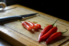 Bunch of chilies on a cutting board. Fresh red chilies on a cutting board Stock Photo