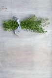 Bunch of Chinese cress on wooden background. Bunch of Chinese cress Capsella herb on wooden background Royalty Free Stock Images