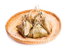 Bunch of Chinese rice dumpling placed on traditional rattan tray Royalty Free Stock Photography