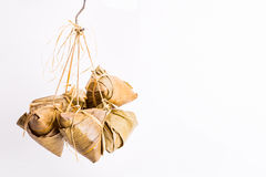 Bunch of Chinese rice dumpling tied hanging against white backgr Royalty Free Stock Photos
