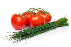 Bunch of chives with tomatoes Stock Photo
