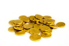 Bunch of chocolate gold coins on white background stock image
