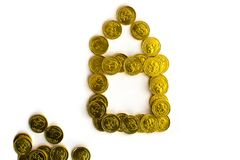 Bunch of chocolate gold coins on white background royalty free stock image