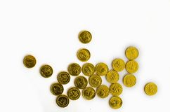 Bunch of chocolate gold coins on white background stock photography