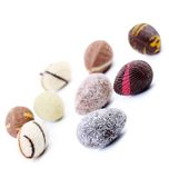 Bunch of chocolate seashells and stones. Stock Photos