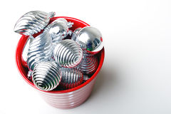 Bunch of Christmas New Year decoration ornaments. Bunch of Christmas New Year silver shiny decoration ornaments in red basket stock photo