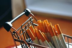A bunch of cigarettes lying in a metal mini cart. Bad habit. The dependence on nicotine royalty free stock photography