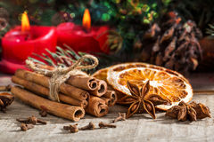 Bunch of cinnamon sticks, anise stars and dried orange Stock Image