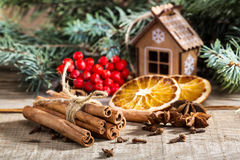 Bunch of cinnamon sticks, anise stars and dried orange Royalty Free Stock Image