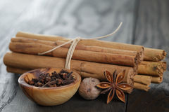 Bunch of cinnamon sticks with nutmeg, anise and cloves Royalty Free Stock Photo