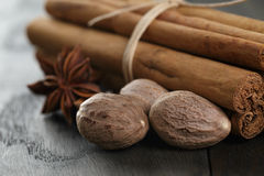Bunch of cinnamon sticks with nutmeg and anise star Royalty Free Stock Photo
