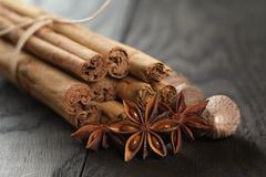 Bunch of cinnamon sticks with nutmeg and anise star Royalty Free Stock Photos
