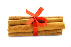 Bunch of cinnamon sticks with red bow Stock Images