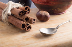 Bunch of cinnamon sticks and vintage silver spoon Stock Photo