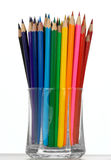 Bunch of color crayons in a glass Royalty Free Stock Images