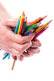 Bunch of color pencils in hands Stock Photos