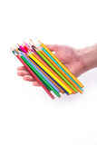 Bunch of color pencils in hands Royalty Free Stock Photography