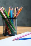 Bunch of color pencils with a white paper sheet Royalty Free Stock Images
