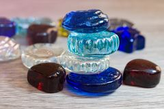 A bunch of colored glass stones for meditation, jewelry, indoor, abstract background,. Close-up Stock Photo