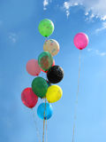 Bunch of colored party balloons against blue sky Royalty Free Stock Photo