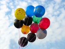 Bunch of colored party balloons against sky Stock Photography