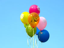 Bunch of colored party balloons over blue sky Royalty Free Stock Photography