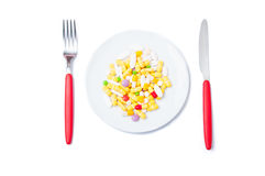 Bunch of colored pills on a white plate Stock Photo