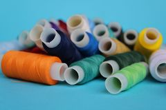 A bunch of colored sewing threads for a seamstress stock images
