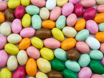 Bunch colored sugared almonds closeup background. Bunch of colored sugared almonds closeup background royalty free stock photos