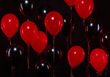 Bunch of colorful balloons on background. Black and red.