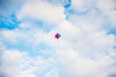 Bunch of colorful balloons in blue sky Stock Photography