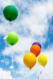 Bunch of colorful balloons in blue sky Stock Images