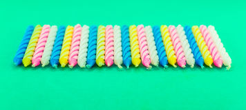 A bunch of colorful Birthday Candles Stock Image
