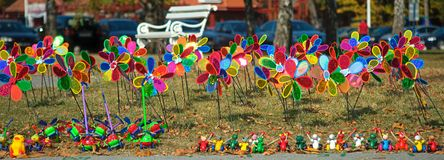 Bunch of colorful children windmill toys on a field stock images