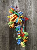 Bunch of colorful cloth pegs. On the nail Royalty Free Stock Image