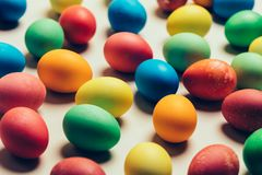 Bunch of colorful eggs laying on the ground. Easter traditions Stock Photo