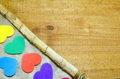 Bunch of colorful hearts on the edge of a frame Royalty Free Stock Photo