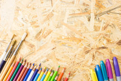 Bunch of colorful pencils markers and paint brushes Stock Images
