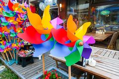 Colorful plastic toy windmills in front of a cafe Stock Photography
