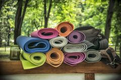 A Bunch of Yoga Mats. A bunch of colorful yoga mats outdoors royalty free stock images