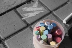 Bunch of coloring chalks in a plastic bucket Royalty Free Stock Photos