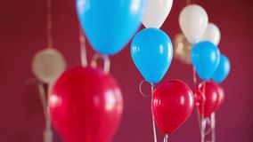 Bunch Of Colourful Balloons On Dark Red Background stock footage