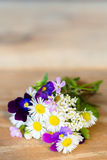 Bunch of colourful garden flowers on wooden table Royalty Free Stock Photo