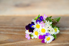 Bunch of colourful garden flowers on wooden table Royalty Free Stock Photography