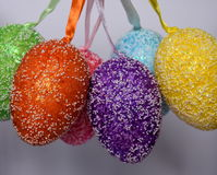 Bunch of colourful panted plastic easter eggs. With white dots. Easter Paschal eggs are decorated eggs that are usually used as gifts on the occasion of Easter Royalty Free Stock Images